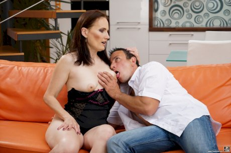 Brunette cougar Alice Sharp sucks the jizz from toy boy's dick after fucking