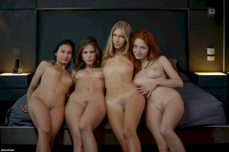 Four hot young models stripped naked and posing nude before lesbian orgy