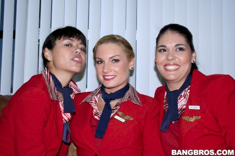 Sexy stewardesses exposes their wonderful bums and big breasts together