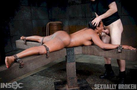 Black female Lisa Tiffian is forced to suck cock while restrained spreadeagled