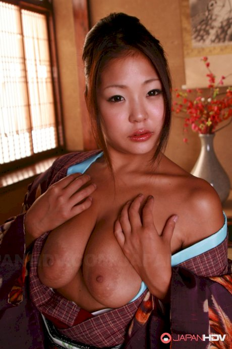 Hot Japanese beauty awakens from sleep to uncover her sexy Asian pussy