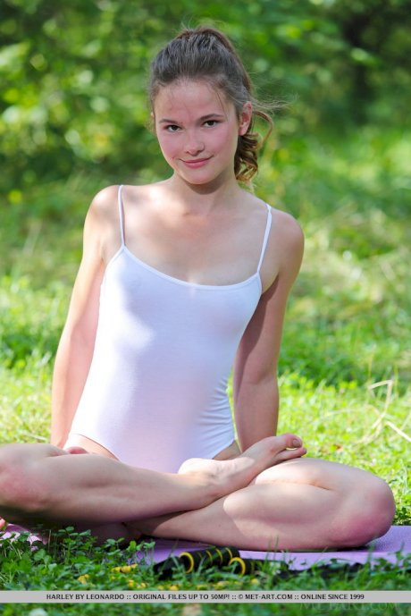 Teen model Harley shows off her flexibility on yoga mat during outdoor workout