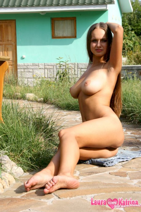 Stunning babe Sasha gets nude outdoors and reveals her huge natural tits