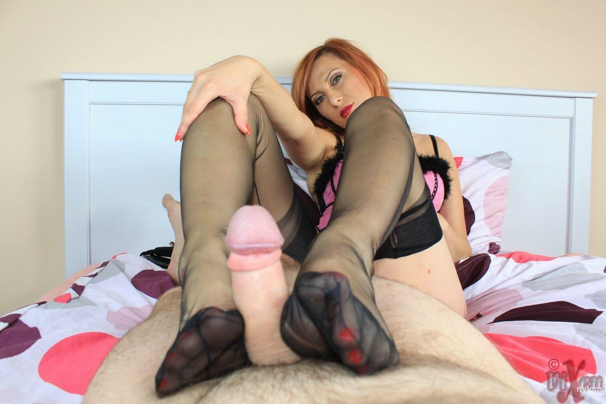 Asian babe in hot lingerie gives nylon footjob under the milking table