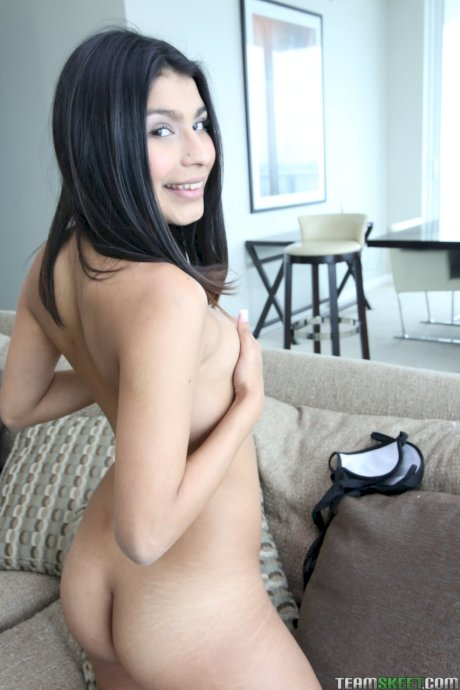 Pretty Latina Miya Stone strips off her clothes and poses on the couch