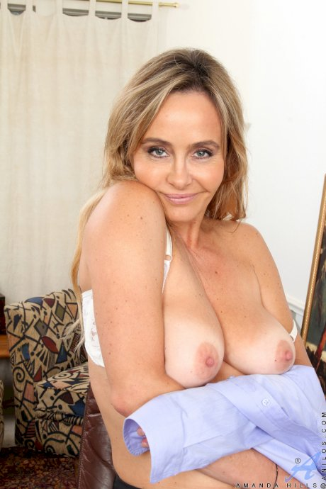 Horny MILF Amanda Hills masturbates her cock-hungry hairy pussy in her office