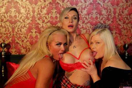 Fat granny Lacey Starr enjoys a lesbian threesome with hot busty MILFs