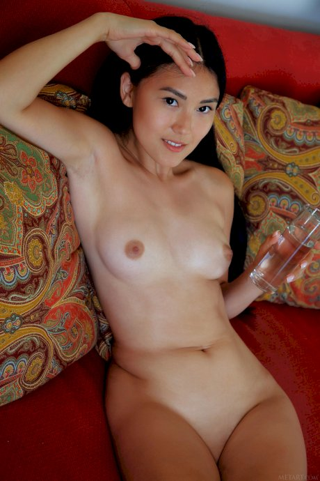 Petite Asian Kimiko shows her playful body and her shaved snatch