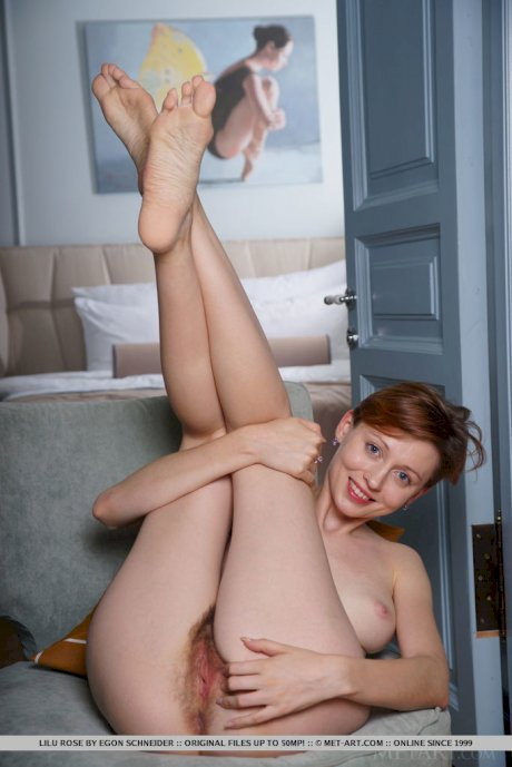 Solo girl with short red hair Lilu Rose doffs a revealing dress to pose nude