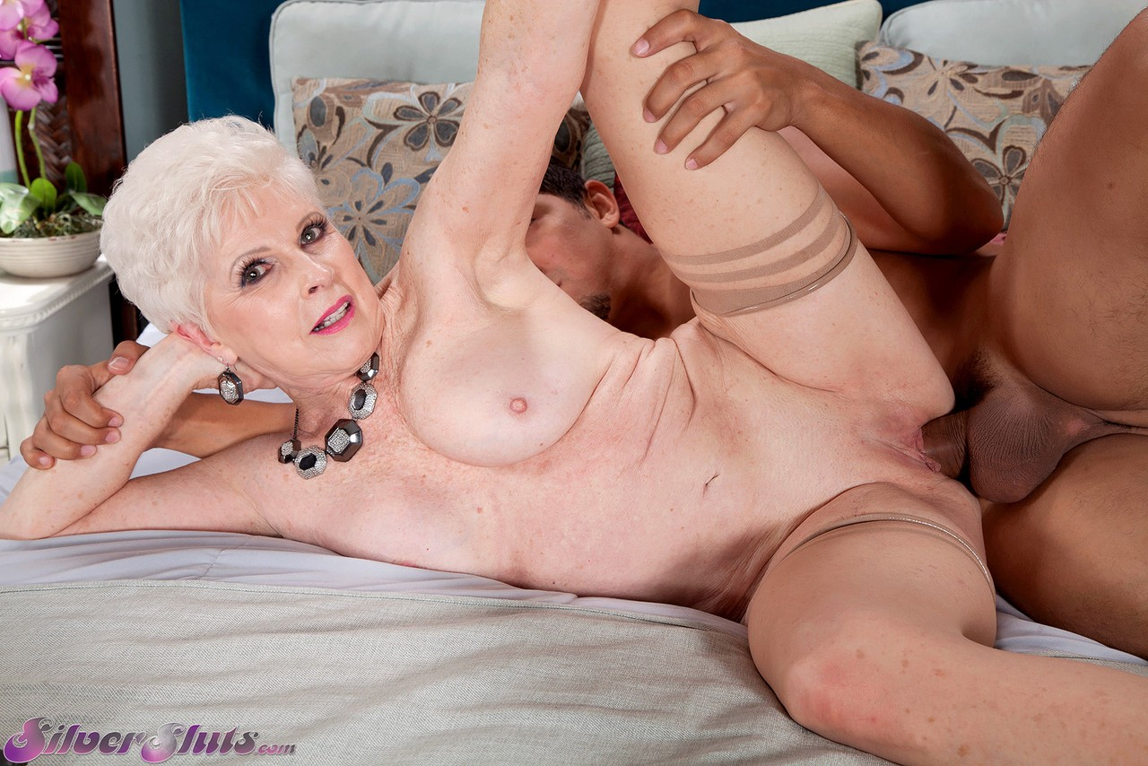 Naughty granny gives a young couple threesome sex lessons