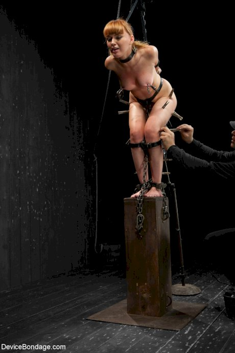 Tied up redhead Marie McCray getting tortured by her master in the dungeon