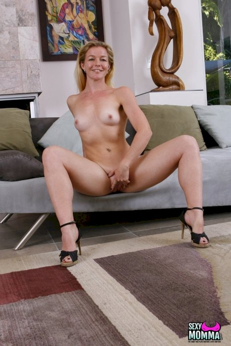 Blonde MILF Shakira strips naked & shows her tiny tits wearing high heels