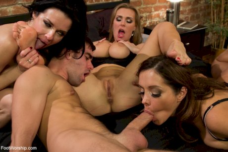 Buxom Veronica Avluv and two other pornstars take care of a cock in foursome