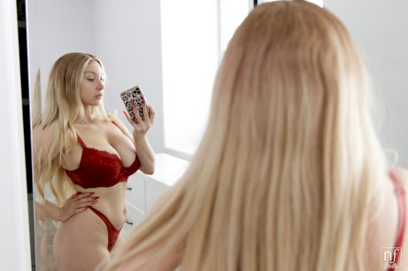 Young blonde Skylar Vox takes mirror selfies prior to having sex