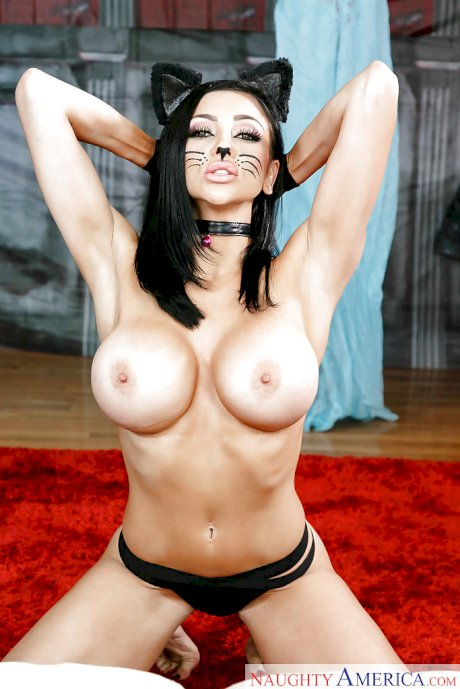 Brunette in sensual costume Audrey Bitoni reveals boobs in slow motion