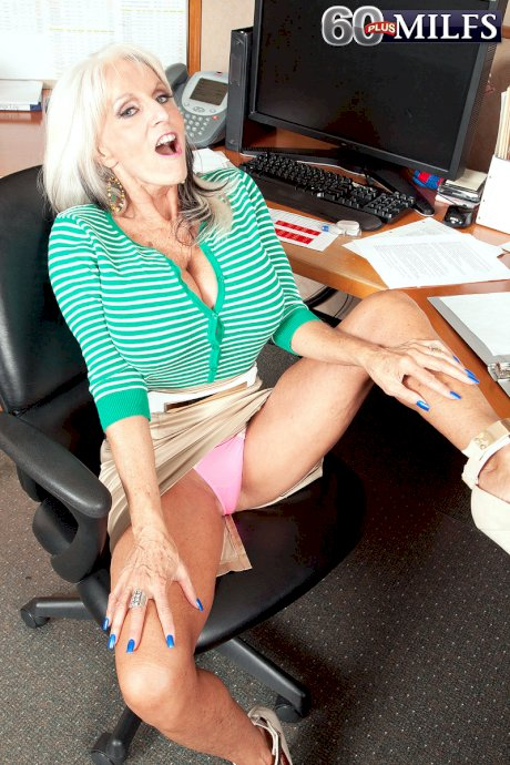 Older secretary Sally Dangelo gets naked on her office chair