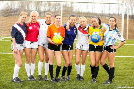 Kinky soccer babes strip each other and flaunt their titties on a soccer pitch