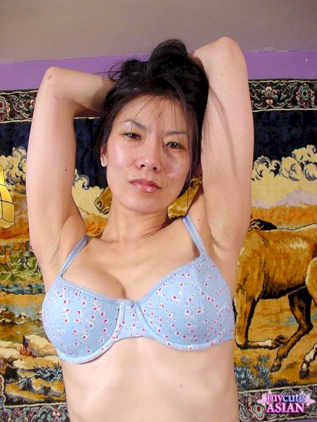 Petite Asian finger spreads her meaty labia lips on bed in solo action