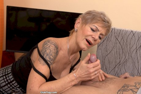 Short haired female Granny Inga tugs on a hard cock until it ejaculates