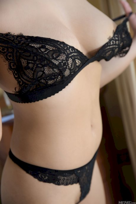 Teen with incredible breasts Kahlisa reveals her hairy muff in a hotel room