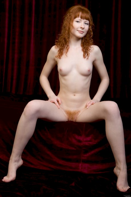 Curly-haired ginger Rochelle A strips naked & showcases her furry snatch