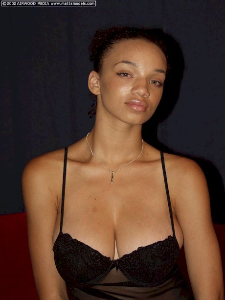 Ebony amateur Gia releases her big naturals from sheer lingerie to get naked