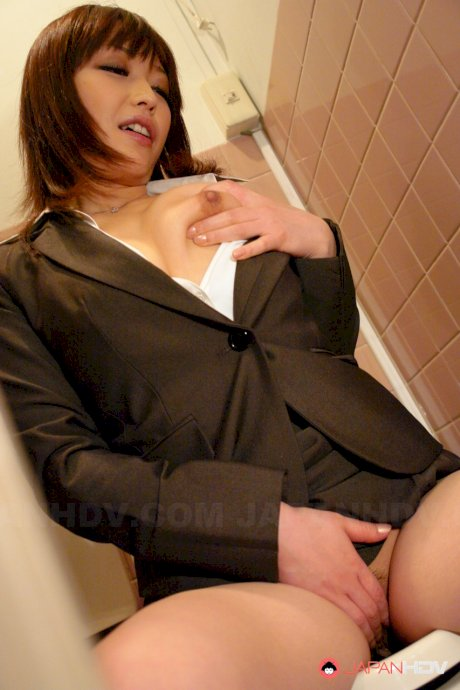 Japanese female Yukina Aoyama rubs her pussy before removing business clothes