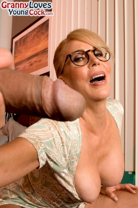 Glasses wearing granny Erica Lauren gives young boy his first sex lessons