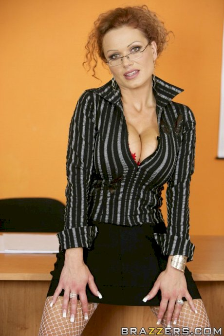 Hot Czech teacher Sharon Pink strips in the classroom & flaunts her giant tits