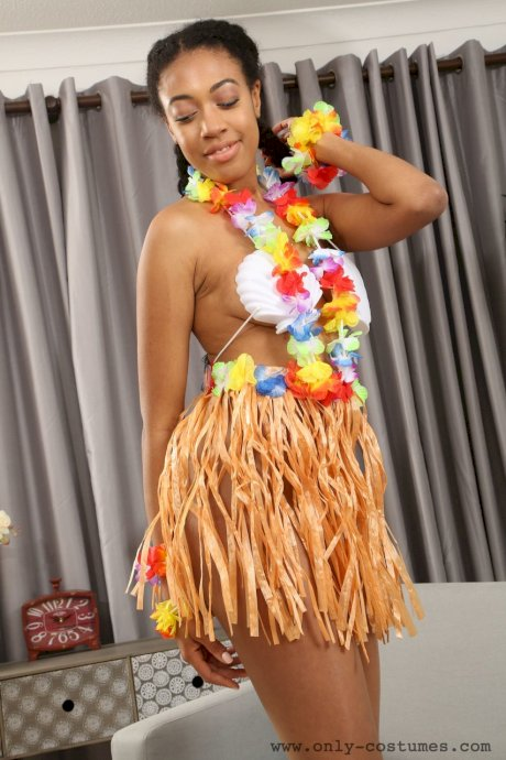 Ebony model Naomi Alicia strips off Hawaiian outfit and poses in pantyhose