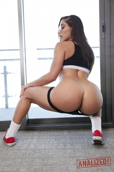 Pornstar Abella Danger strips to show sexy big ass & trimmed twat on the floor