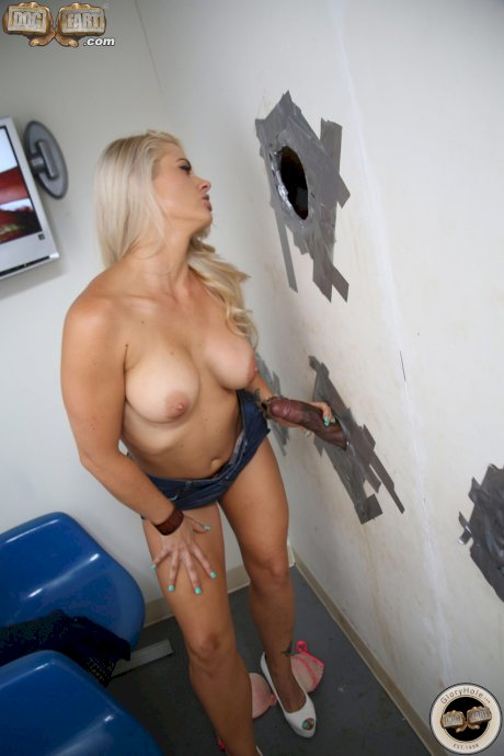 Blonde Holly Heart unveils her naturals and gets banged by a gloryhole dong