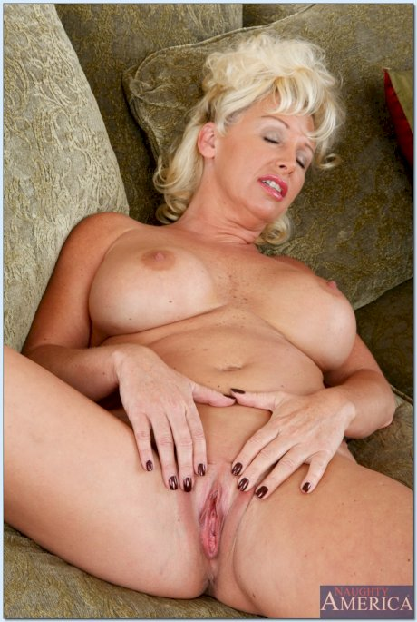 Busty inked blonde Dyanna Lauren poses nude before getting nailed hard