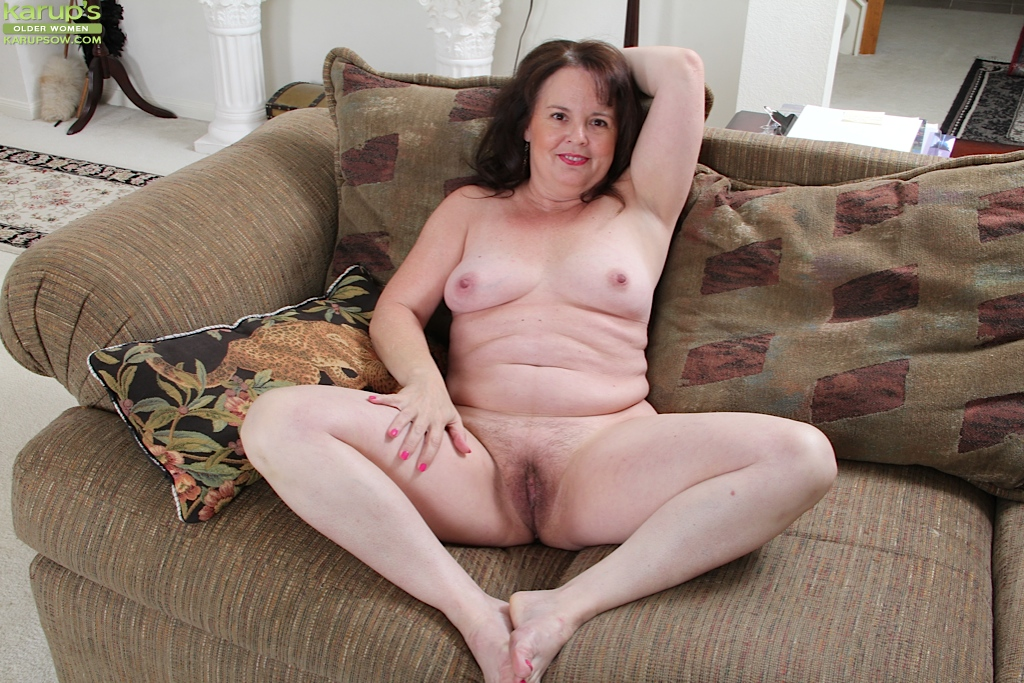 Chubby mature housewife with giant tits strips off