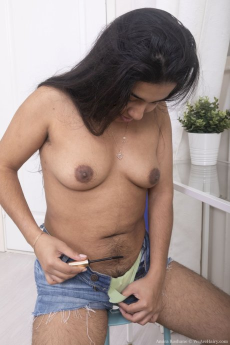 Hot brunette Amira Roshane shows off her beautiful tits & her very hairy pussy