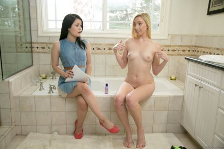Crafty naked Zoe Parker undresses young assistant for lesbian bathroom fun