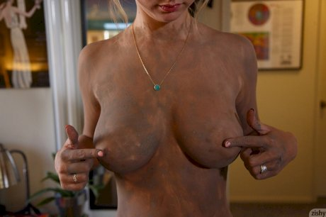 Slender solo girl Lily Ivy puts her nice tits forward while standing naked
