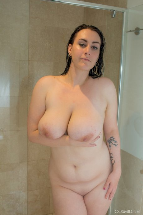 Chubby housewife Chloe Jenks showering her massive breasts