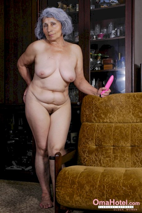 Grey haired granny Karla shows her saggy breasts and plays with a pink toy