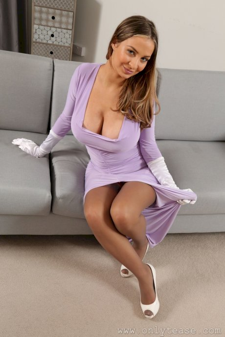 Sophisticated babe Suzie Q strips off purple dress and exposes massive juggs