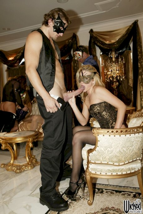 Masked women with hot bodies in lingerie enjoy group banging in a royal room