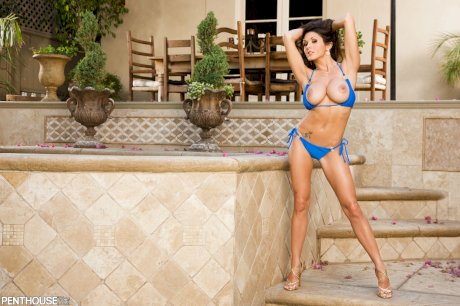 Solo model Taya Parker takes off a bikini for a nude centerfold shoot outdoors