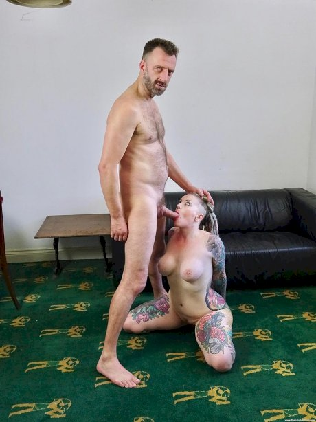 Tattooed female Piggy Mouth slurps on a dick before vaginal sex