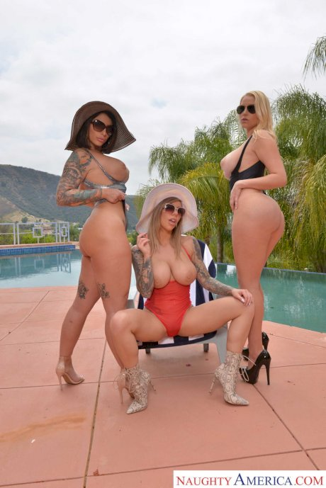Pornstars show off their big fake tits and tight booties in their swimsuits