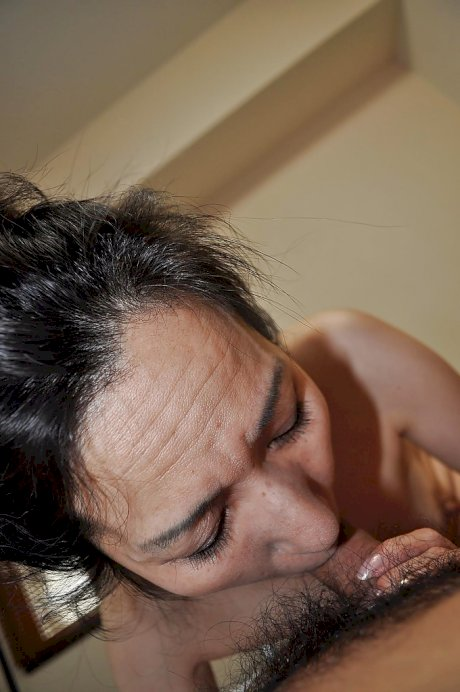 Mature asian slut gives head and gets her shaggy twat shafted tough