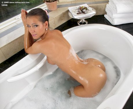 Beautiful solo girl with a perfect ass gets into a soaker tub