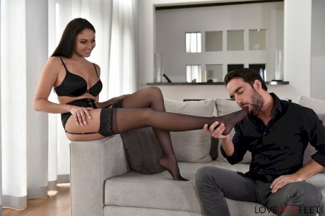 Hottie in black stockings Ariana Marie gives a hot footjob & rides a hard cock