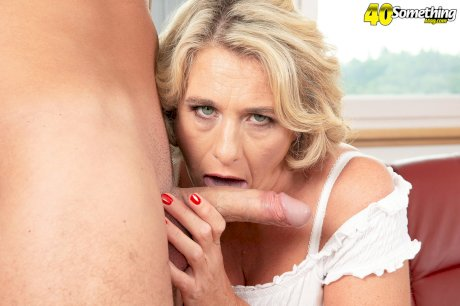 Big titted middle-aged blond Camilla seduces the pool cleaner in cutoff shorts