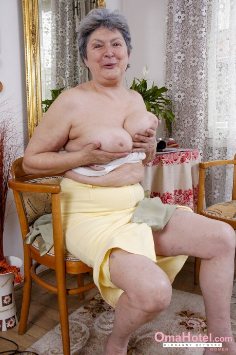 Busty British granny Camilla Creampie	uses her old sex toy while masturbating
