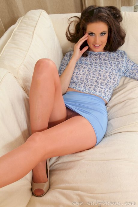 Playful babe Petra V touches herself while posing in hot pantyhose on the sofa
